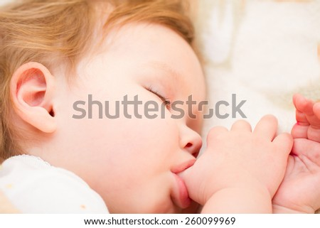 Adorable little girl sleeping in a bed - stock photo