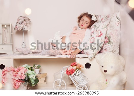 Adorable little girl sleeping in her room - stock photo