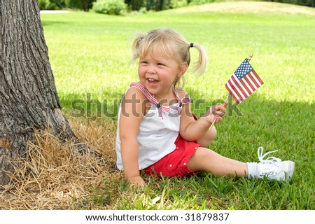 Adorable little girl smiling and waving American flag outside - stock photo