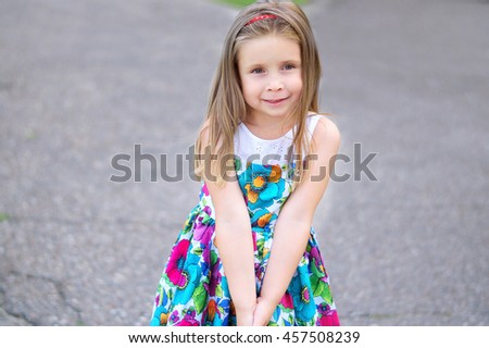 Adorable little girl smiling in a park - stock photo