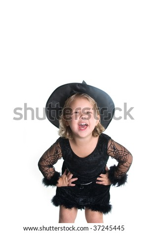 Adorable little girl smiling in witch costume on white background - stock photo