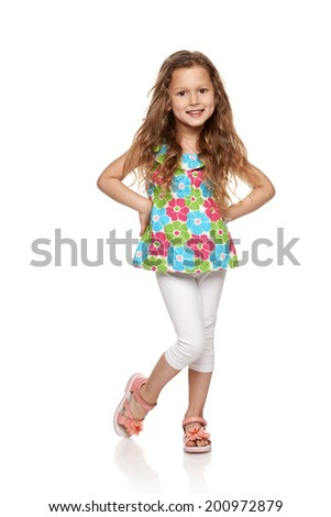 Adorable little girl standing in full length over white background - stock photo