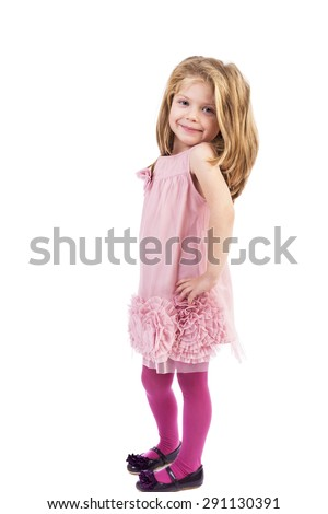 Adorable little girl standing with hands on hips over white background - stock photo
