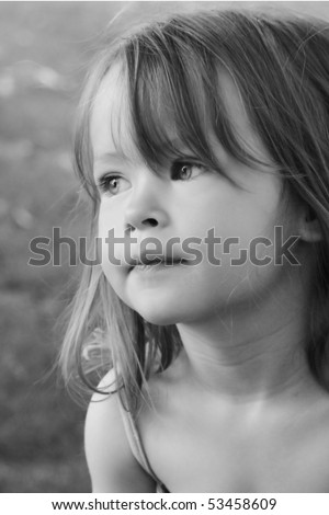 Adorable little girl taken closeup outdoors in summer (black and White)