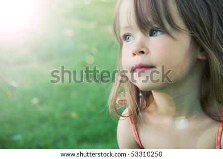 Adorable little girl taken closeup outdoors in summer - lighting effect - stock photo