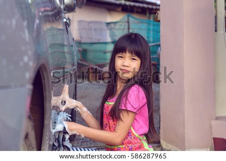 nude asian washing car