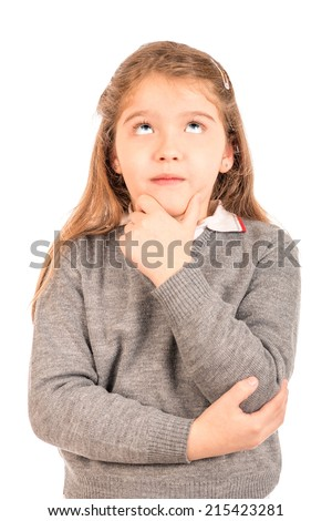 Adorable little girl wearing a school uniform thinking and looking up - stock photo