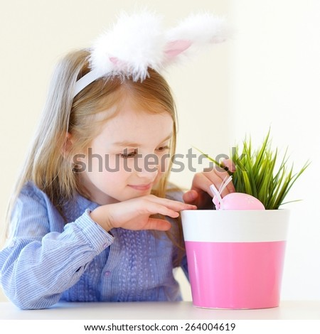 Adorable little girl wearing bunny ears on Easter day - stock photo