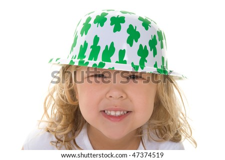Adorable little girl wearing St. Patrick's Day hat - stock photo