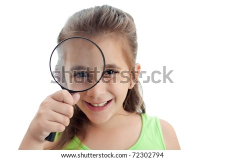 Adorable little girl with a magnifying glass isolated on a white background - stock photo
