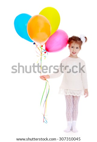 Adorable little girl with a ponytail tied with a white bow on her head holding a bunch of colourful balloons. The girl dressed in a short white dress and white tights-Isolated on white background - stock photo