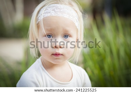 Adorable Little Girl with Blue Eyes Portrait Outside. - stock photo
