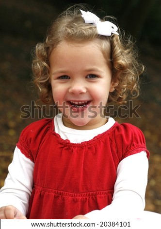 adorable little girl with curly hair, smiling - stock photo