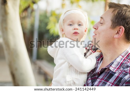 Adorable Little Girl with Her Daddy Portrait Outside. - stock photo