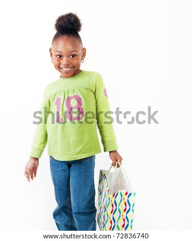 Adorable little girl with her shopping bag - stock photo