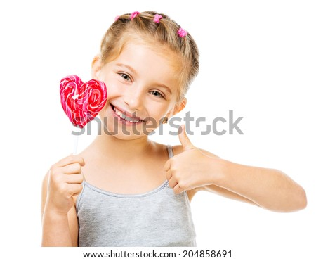 Adorable little girl with red lollipop in heart shape isolated over white background - stock photo