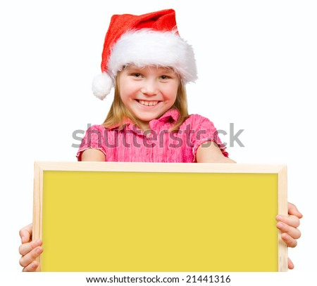 Adorable little girl with Santa hat holding empty board - stock photo