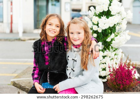 Adorable little girls having fun outdoors - stock photo