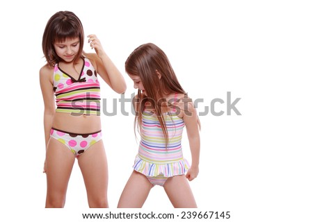 adorable little girls posing as a fashion models isolated over white background  - stock photo