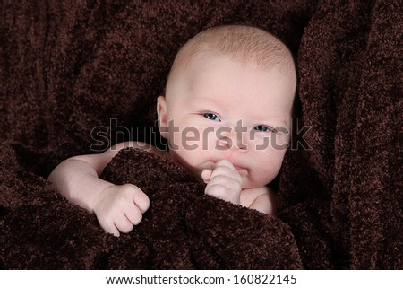 Adorable little newborn baby girl on background