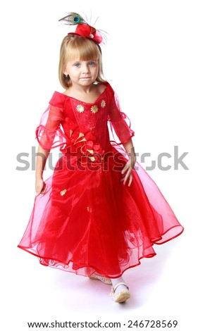 Adorable little princess in a long bright red dress.Isolated on white background - stock photo