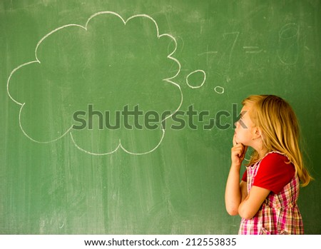 Adorable little school blonde girl in school classroom on board posing with cloud for copy space - stock photo