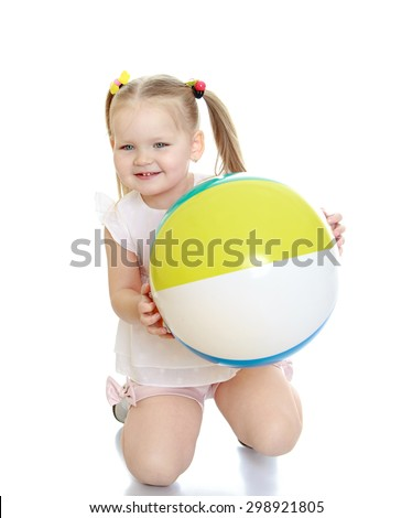 Adorable little white girl with her hair braided in pigtails is kneeling and holding in front of a big striped beach ball, girl shoves parents in the seaside resort.-Isolated on white background - stock photo