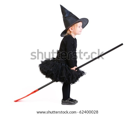 Adorable little witch on broomstick isolated on white - stock photo