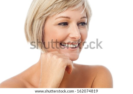 Adorable middle aged lady looking away - stock photo