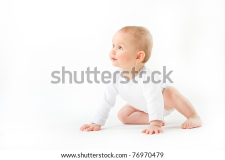 Adorable 7 month old baby girl sitting over white. - stock photo