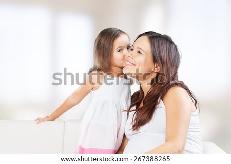 Adorable. Mother and Baby kissing and hugging. Happy Family - stock photo