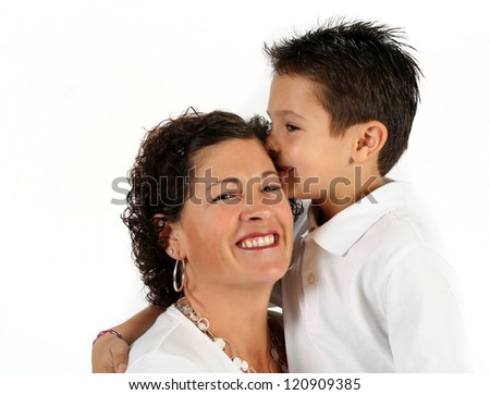 Adorable mother and son kissing on white background