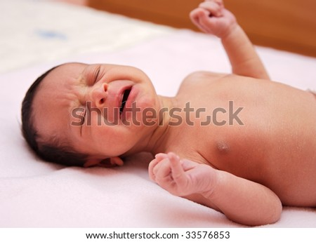 adorable new born baby crying and shouting - stock photo