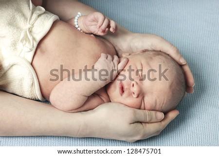Adorable newborn baby - stock photo