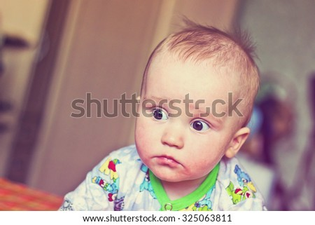 Adorable newborn baby boy serious portrait. Image with vintage filter - stock photo