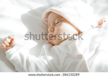 Adorable Newborn baby peacefully sleeping. Closeup Portrait. Toned in soft color. Studio shot, Horizontal - stock photo