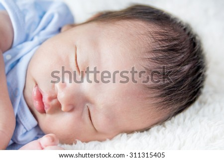 Adorable newborn baby sleeping