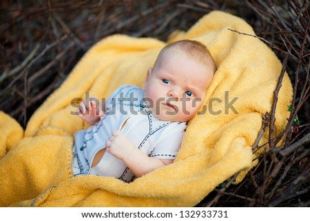 Adorable newborn baby with towel