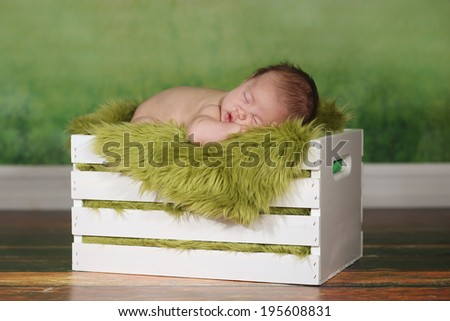 Adorable Newborn Infant Boy Sleeping on a Cute Set - stock photo