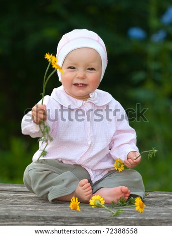 adorable one-year old baby sitting and smiling - stock photo