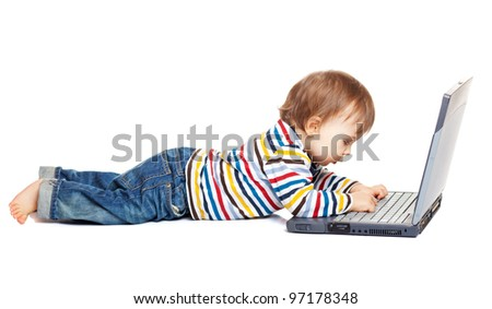 Adorable one year old child trying to use laptop, isolated on white - stock photo
