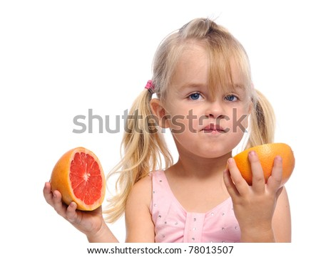 adorable pigtails blonde girl does not like the taste of grapefruit