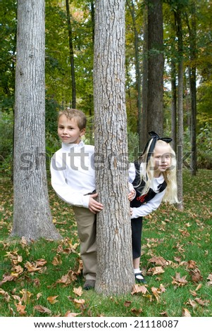 Adorable portrait of a brother and sister - stock photo