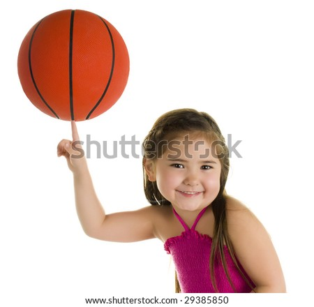 Adorable Pre-Schooler Balancing a Basketball on one Finger. - stock photo