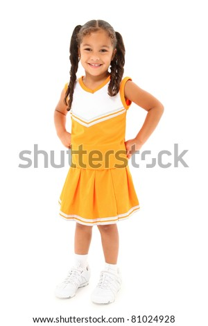 Adorable preschool girl child cheerleader in uniform over white background. - stock photo