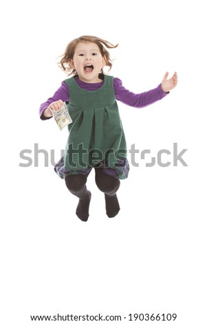 Adorable preschooler holding a one hundred dollar bill in US currency and jumping for joy.  Isolated on white. - stock photo