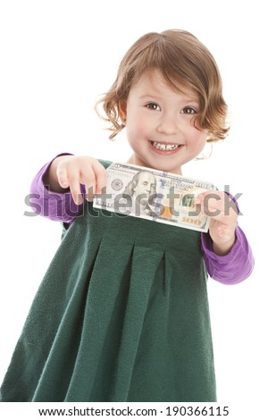 Adorable preschooler with a one hundred dollar bill in US currency.  Isolated on white. - stock photo