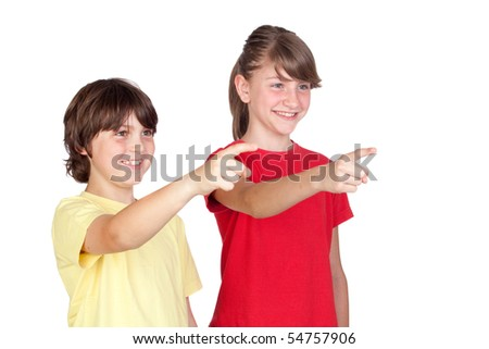 Adorable preteen girl and little boy finger pointing isolated on white background - stock photo