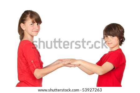 Adorable preteen girl and little gir in red isolated on white background - stock photo