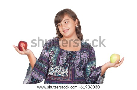 Adorable preteen girl with two differents apples isolated on white background - stock photo